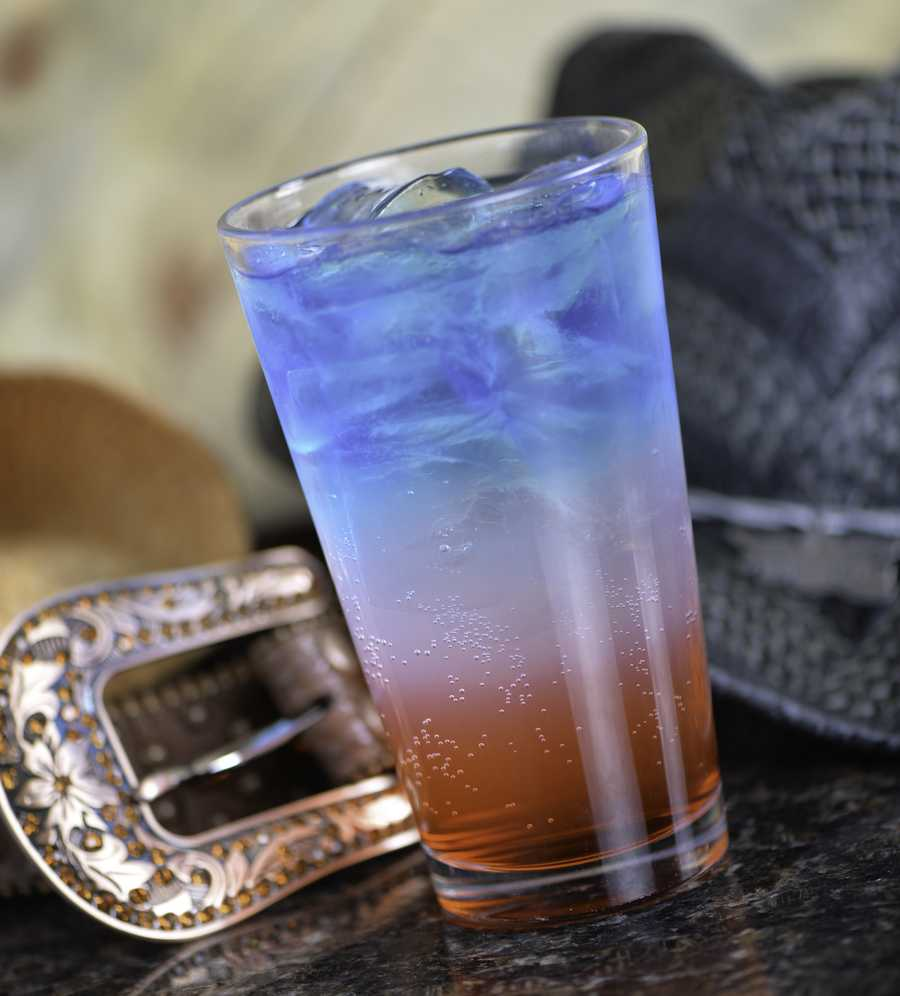 American Girl(16oz Glass)½ Bottle Smirnoff Ice1 oz. Wave Blue Raspberry Vodka½ oz. Blue Curacao½ oz. GrenadineFill 16 oz. glass with ice and pour half of Smirnoff Ice in.Add ½ oz. Grenadine to sink to the bottom.Shake Blue Vodka and Blue Curacao over ice, and gently strain over spoon or cherry to layer the top. End product should be from top to bottom: Red, White & Blue