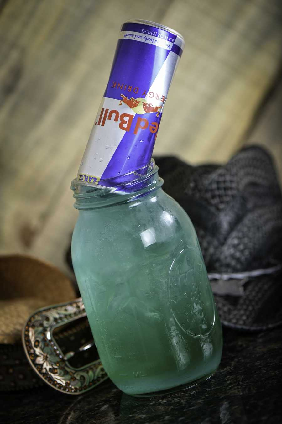 Red Bullfrog(32 oz mason jar)1 oz. Wave Blue Raspberry Vodka1 oz. Cruzan Raspberry Rum1 oz. Blue Curacao2 oz. Lemon-Lime Soda1/2 oz. Sweet & SourFill 32oz mason jar ¾ with ice and build drink in the glass.Open and invert Red Bull can into the drink and serve.Recommend over: cocktail with Redbull.