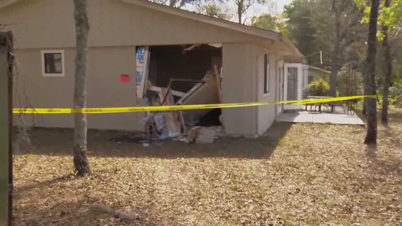 Two Port Orange residents are unharmed after a van slammed into their home Thursday afternoon.