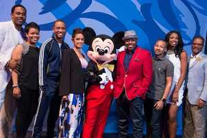 (L-R) Actor Lamman Rucker, Steve Harvey Morning Show producer Monica Barnes, E! News co-anchor Terrence Jenkins, HLN's The Daily Share anchor Rocsi Diaz, filmmaker Will Packer, entrepreneur Jaylen Bledsoe, singer Coco Jones and Disney Imagineer Dex Tanksley pose March 7, 2015 with Mickey Mouse at Epcot in Lake Buena Vista, Fla. during a break from speaking at Disney Dreamers Academy with Steve Harvey and Essence Magazine. The eighth annual event, taking place March 5-8, 2015 at Walt Disney World Resort, is a career-inspiration program for 100 high school students across the U.S. (Mariah Wild, photographer)
