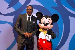 Orlando Magic shooting guard Victor Oladipo poses March 7, 2015 with Mickey Mouse during Disney Dreamers Academy with Steve Harvey and Essence Magazine at Epcot in Lake Buena Vista, Fla. The eighth annual event, taking place March 5-8, 2015 at Walt Disney World Resort, is a career-inspiration program for 100 distinguished high school students across the U.S. (Mariah Wild, photographer)