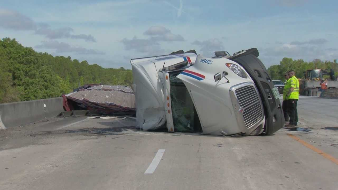 An overturned semi-truck prompted road closures on Interstate 95 in Volusia County Thursday.