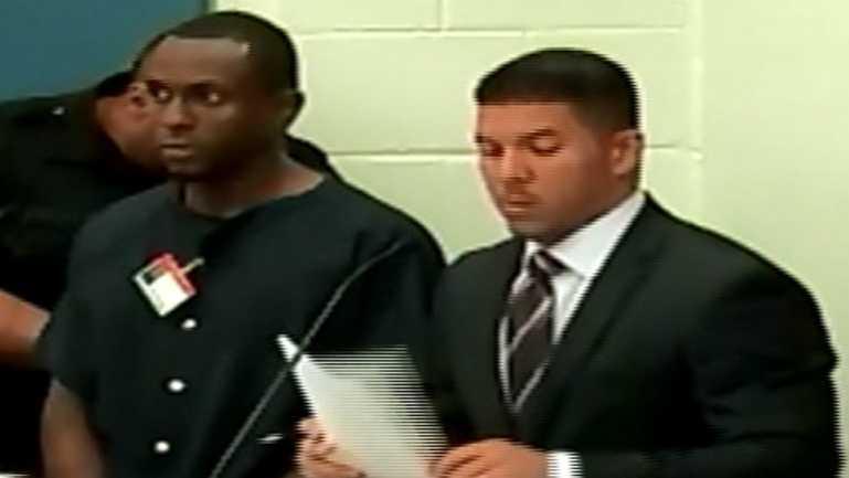 Jean Barreau and Assistant Public Defender Emanuel Soto Diaz at a court session Saturday afternoon.
