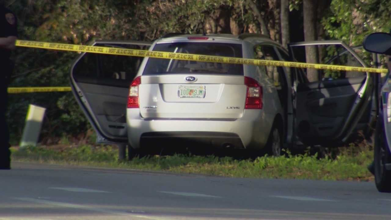 Two people are under arrest two months after a woman was found shot to death in an SUV in Eustis.