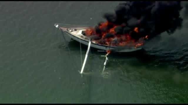 Chopper 2 video shows a boat engulfed in flames Friday afternoon in Brevard County. Two people and two pets were rescued.