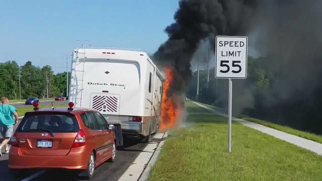 Fire destroys a motor home as it heads through Central Florida on the way to Michigan.