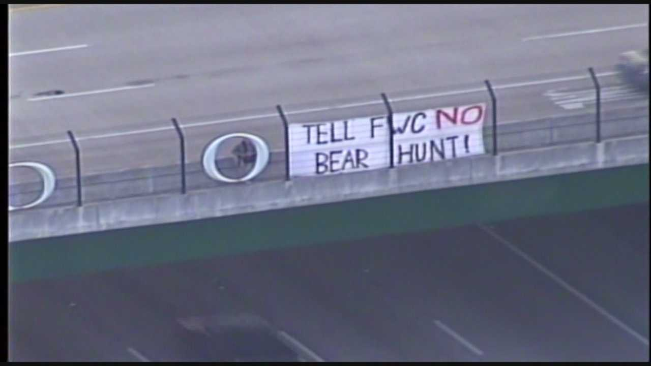 Bear hunting opponents caught the attention of Orlando drivers with a sign above Interstate 4 on Monday.