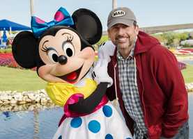 Actor and comedian Steve Carell poses with Minnie Mouse at the Epcot International Flower & Garden Festival. Carell visited the theme park while on vacation with his family at Walt Disney World Resort.