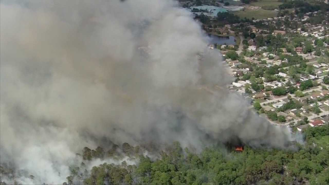 A brush fire in Port Orange shuts down roads, businesses and delays a construction deal on Tuesday.
