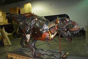Dinosaur made from farm tools
