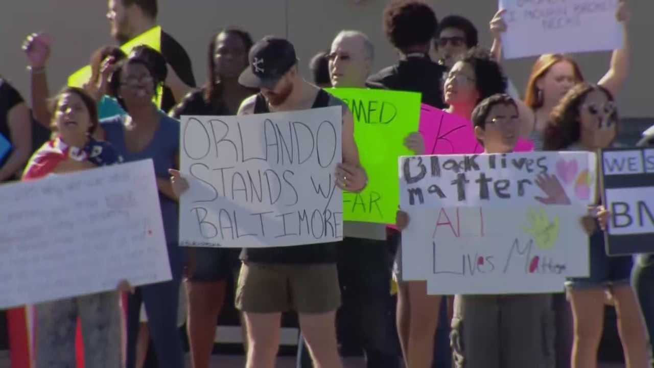 Protesters spread their message in downtown Orlando voicing concerns about those killed in police custody.