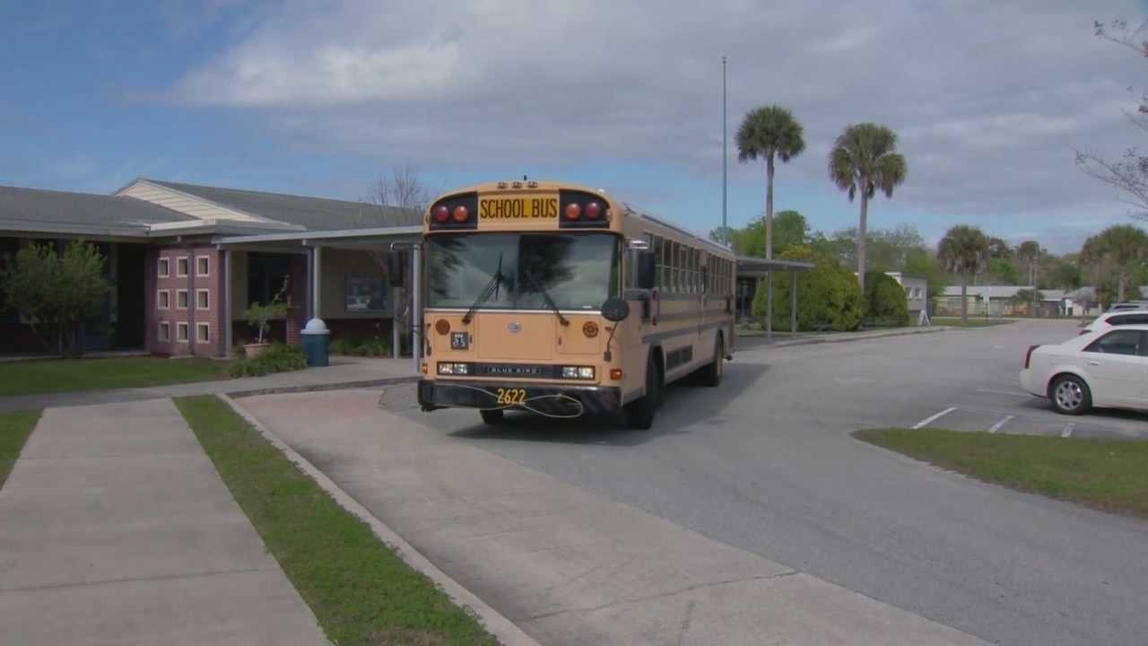 A Volusia County Schools bus monitor has been reassigned after two students came forward claiming he touched them inappropriately, police said.