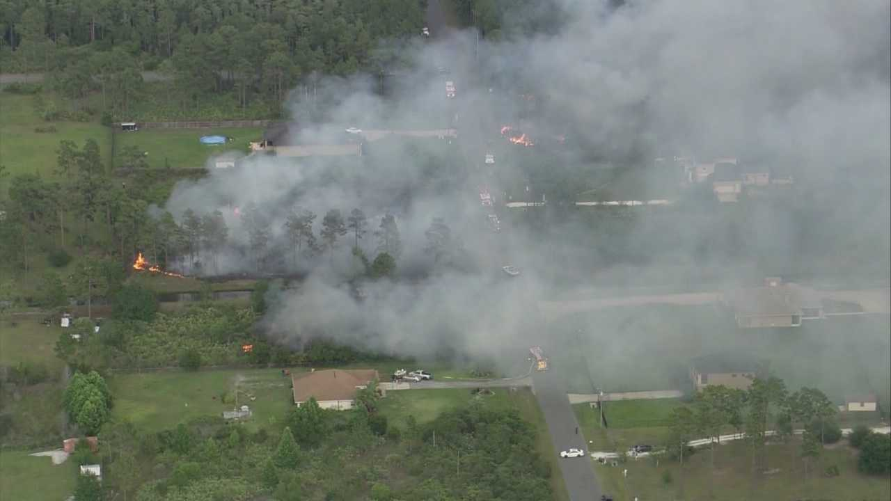 Firefighters battled a 10-acre brush fire near homes in east Orange County on Tuesday.