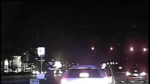 The Orlando Police Department has released video showing an officer get run over by a car early Monday morning. The officer is in stable condition, and police are still searching for the suspects.