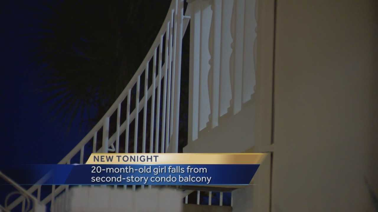 A toddler fell off a second-story balcony after climbing through the railing.