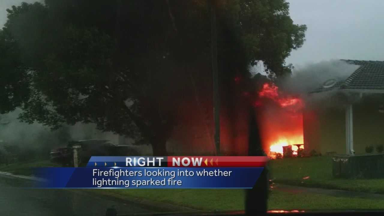 Fire officials believe lightning is to blame for a house fire that was contained to the garage.