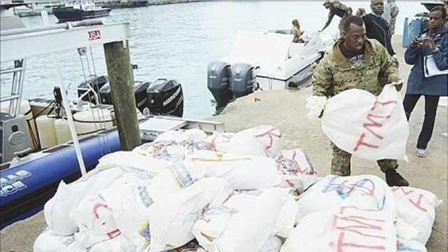 A Bahamian official offloads bales of marijuana in Nassau, Bahamas, Sept. 6, 2015. The contraband was seized during an interagency operation, Operation Bahamas, Turks and Caicos, designed to combat drug smuggling to and from the Bahamas.