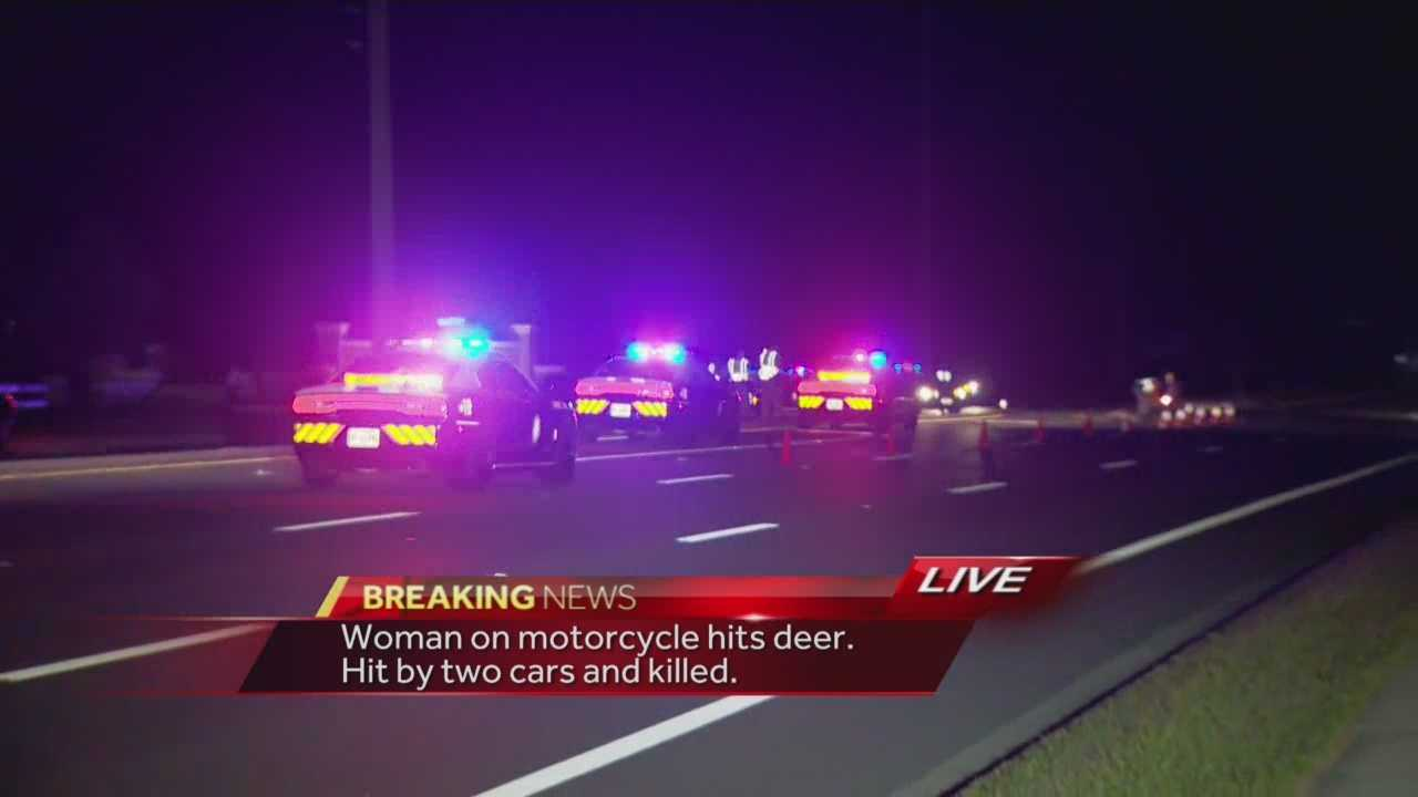 Troopers said a motorcyclist struck a deer Friday night. A woman, who was a passenger on the motorcycle, flew off the motorcycle and was hit by two other cars. She died at the scene.