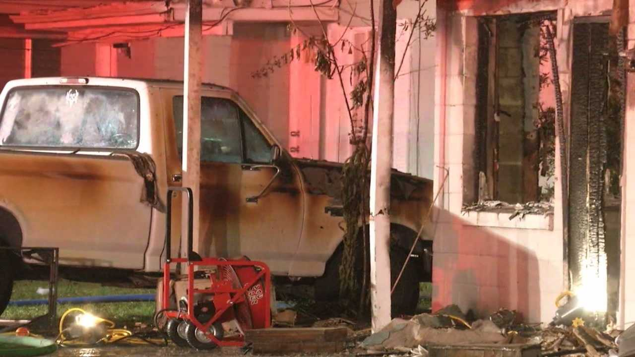 A man's body was found in the burning home, officials said.