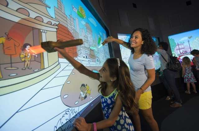 """In """"Color Our World"""", guests can play with fun color shadows while they wait to receive a magic paint brush, which they can use in the studio to bring the world around them to life with their personal color choices."""