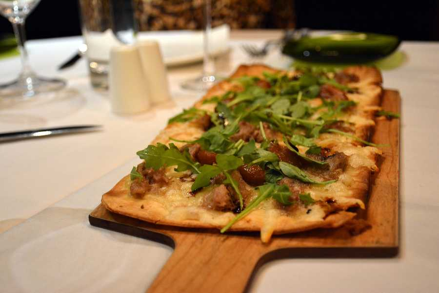 A chef's special flatbread made with duck confit, figs and arugula.