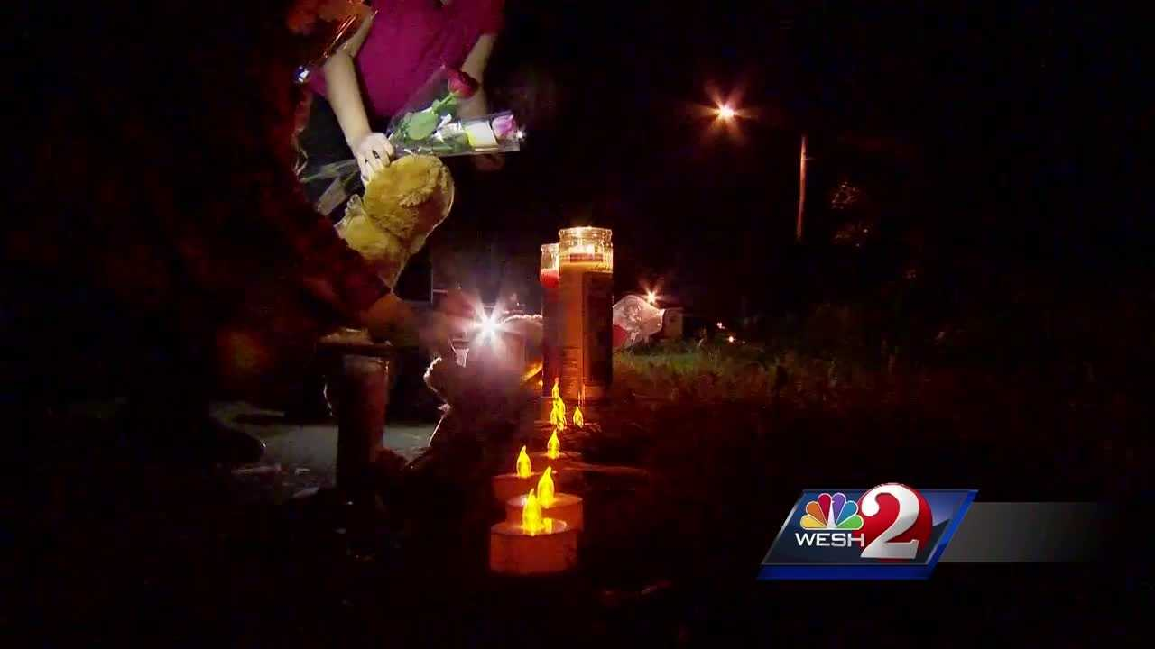 Loved ones remembered the lives of a slain mother and daughter this weekend by lining the curb of their Pine Hills home with candles, teddy bears and roses.
