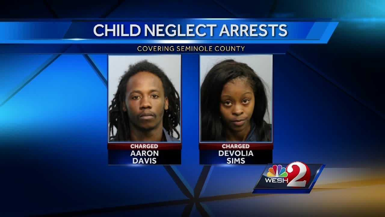 A man and woman face child neglect charges after investigators say a child was shot inside a garage in Sanford.