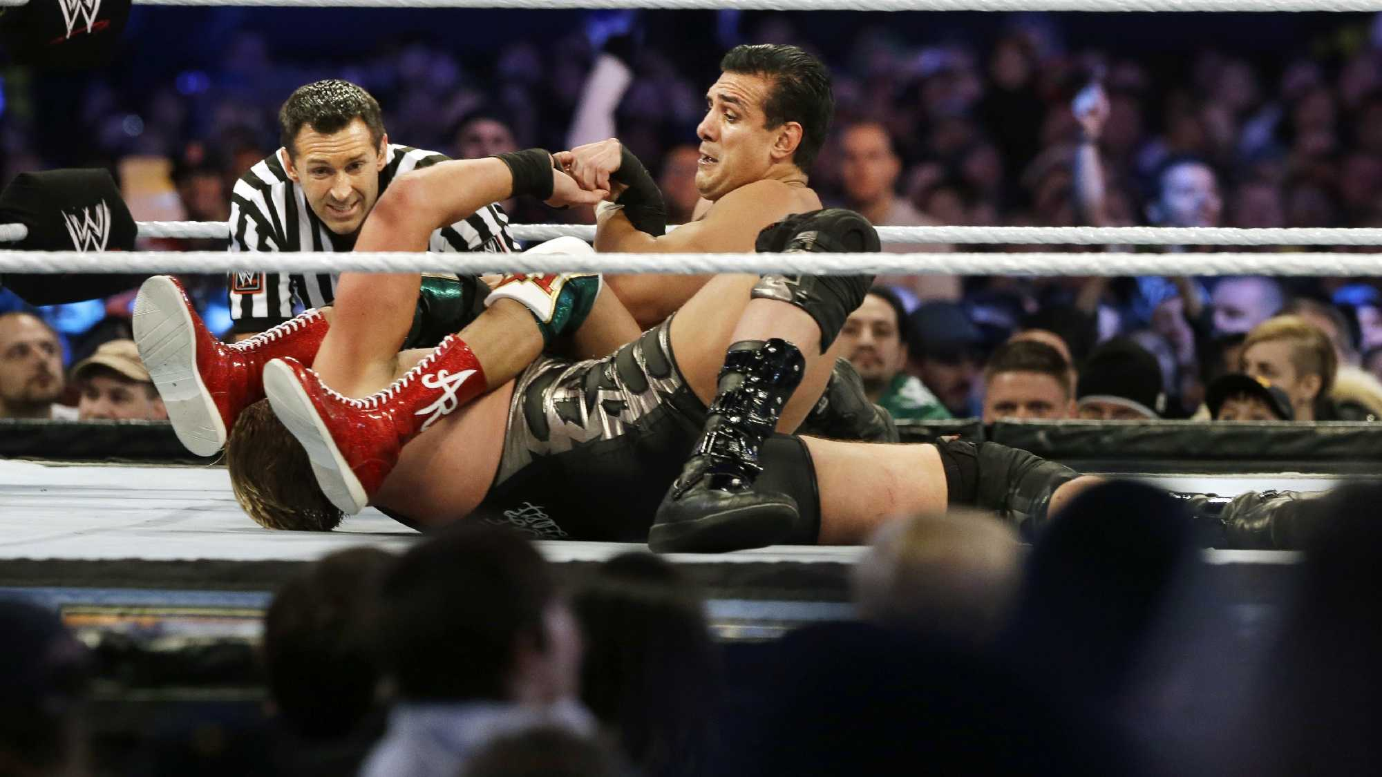 "Jose Alberto Rodríguez, top, of Mexico, known as Alberto Del Rio wrestles Jacob ""Jake"" Hager, Jr., known as Jack Swagger, Sunday, April 7, 2013, in East Rutherford, N.J., during the WWE Wrestlemania 29 event."