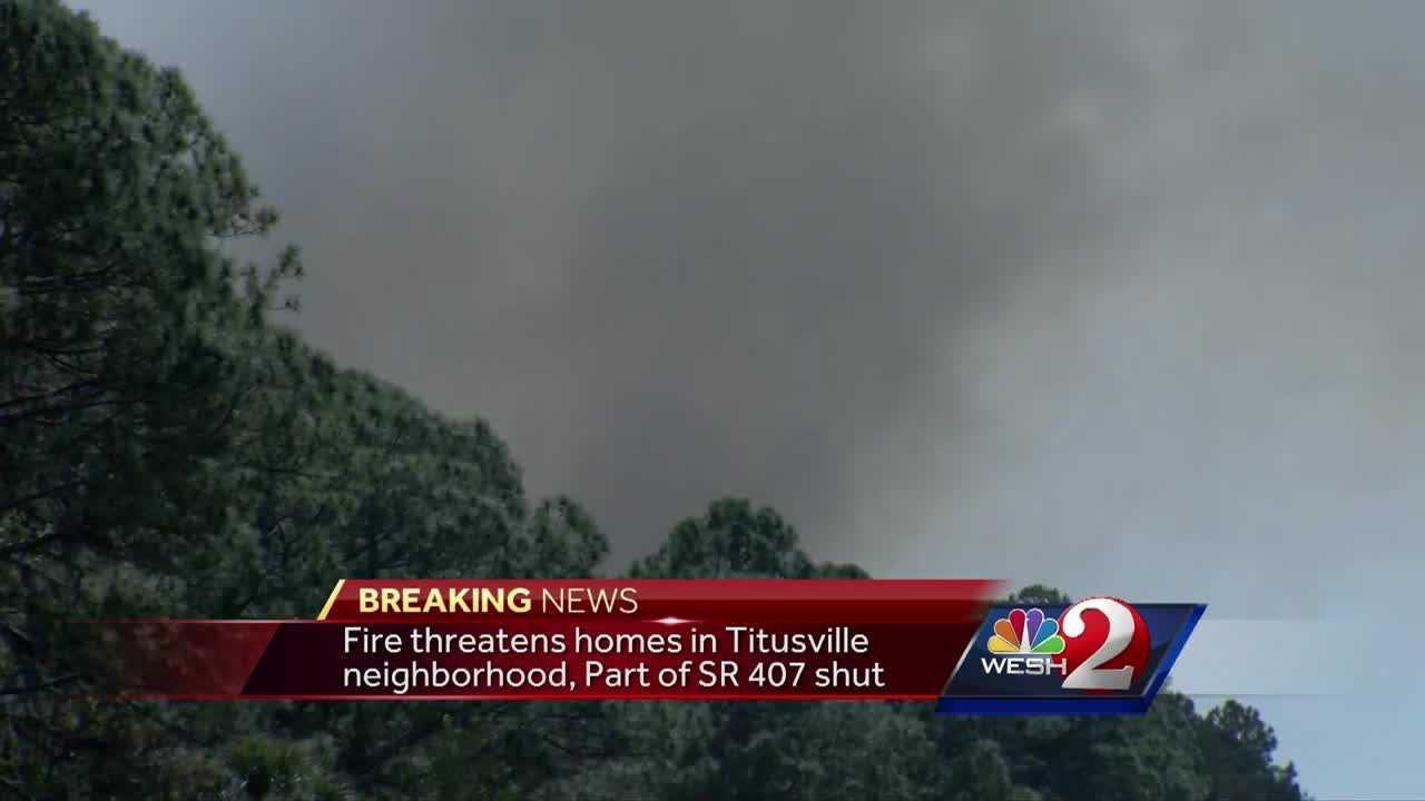 Part of State Road 407 is still shut down. Firefighters are working to keep a fire from moving toward homes in Titusville. Dan Billow (@DanBillowWESH) has the latest update.