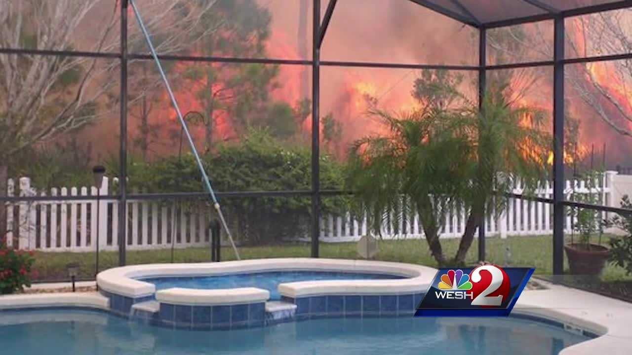 Crews battled a brush fire Monday afternoon as flames tore through east Orange County, posing a threat to some homes. Firefighters and homeowners frantically tried to get the flames out. Summer Knowles reports.