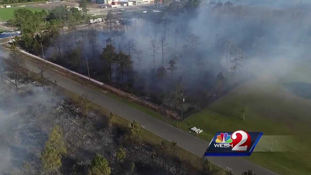 Firefighters have knocked down a brush fire that burned approximately 20 acres in a residential area of eastern Orange County, fire officials say.