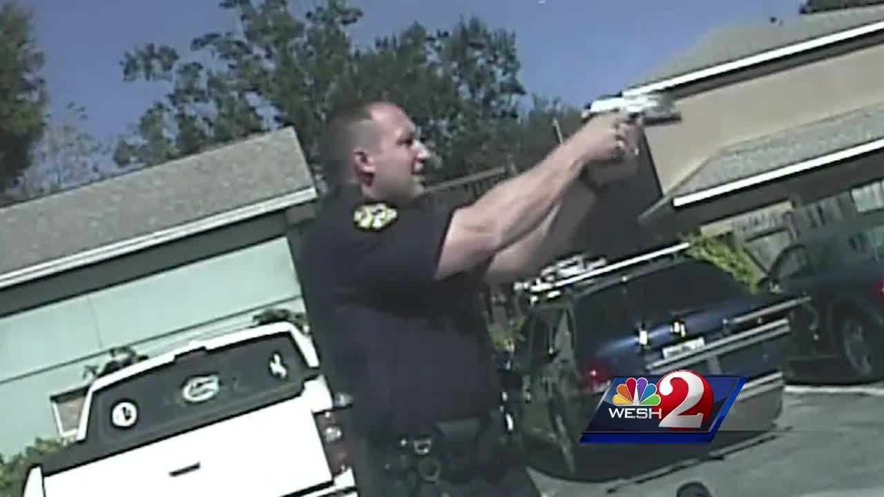 Dramatic, newly-released video shows the moment Orlando police officers were forced to open fire on a car jacking suspect.