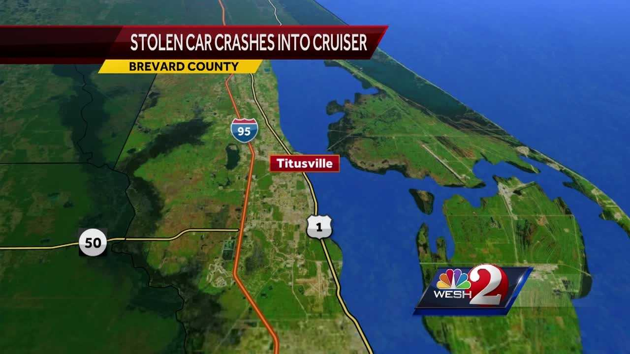 One person has been arrested and two people are wanted by authorities after a stolen vehicle crashed into a Titusville police cruiser Wednesday evening, officials said.