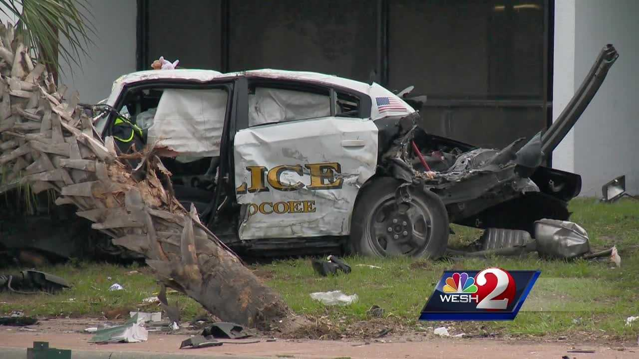 Two armed robbery suspects out of Altamonte Springs remain at large after a pursuit involving Ocoee police led to a serious crash between a police cruiser and an unrelated vehicle Thursday morning.