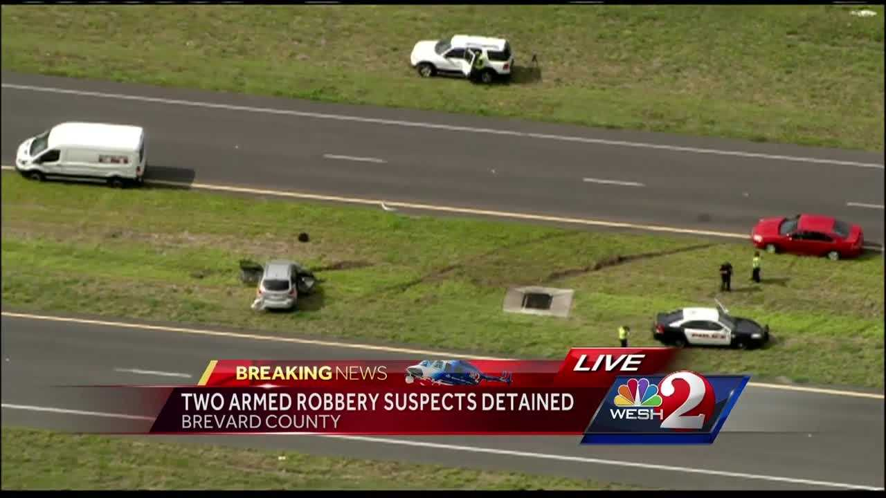 Two people were taken into custody Wednesday after they allegedly robbed a Verizon Wireless store and then led authorities on a multi-county police chase, authorities said. Stewart Moore reports.