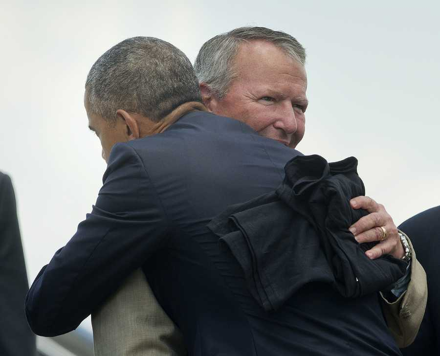 "President Obama hugs Orlando Mayor Buddy Dyer. Dyer showed the president a black ""Orlando Pride"" t shirt with a rainbow heart."