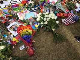 Flowers left at the Dr. Phillips Performing Arts Center Memorial by President Barack Obama and Vice President Joe Biden.
