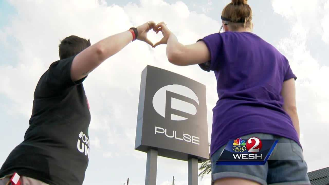 A new memorial for victims of Orlando's nightclub massacre is growing outside Pulse nightclub. People started flocking to the site of the worst shooting in recent U.S. history after Orange Avenue reopened on Tuesday. Chris Hush reports.