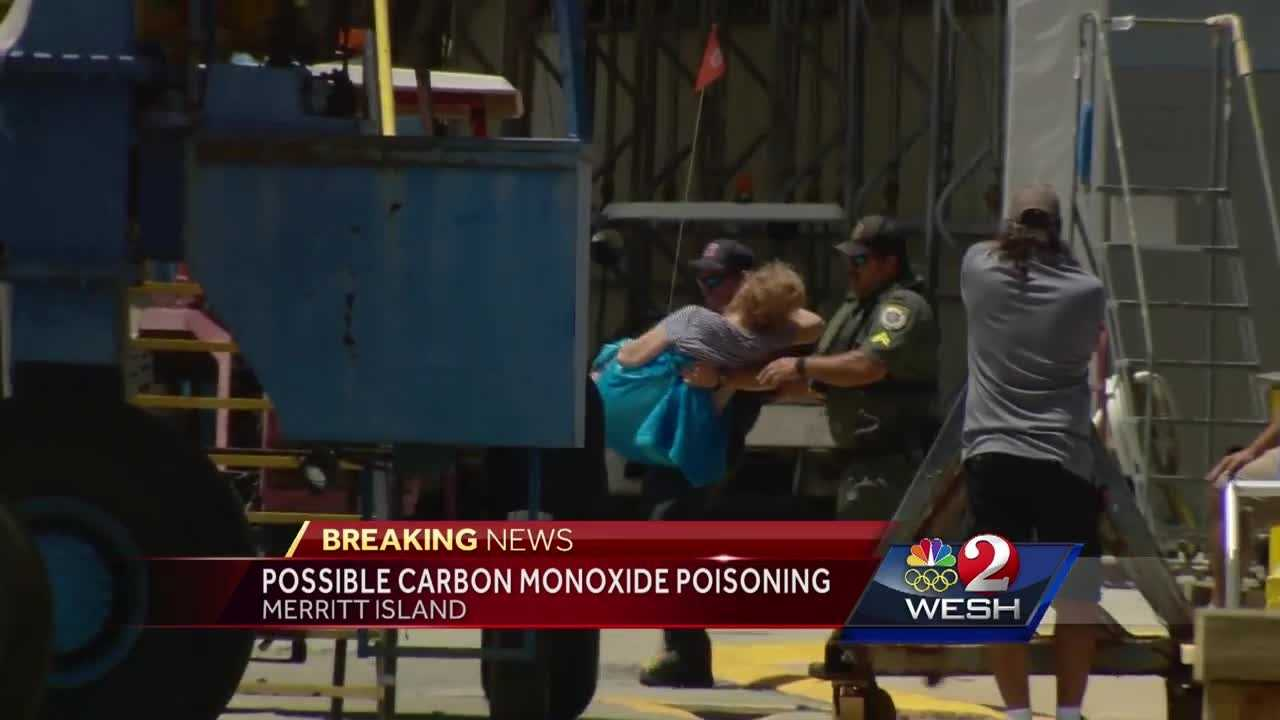 Four people, including at least one child, are being treated for possible carbon monoxide poisoning after being rescued from a vessel in the barge canal in Merritt Island. Dan Billow reports.