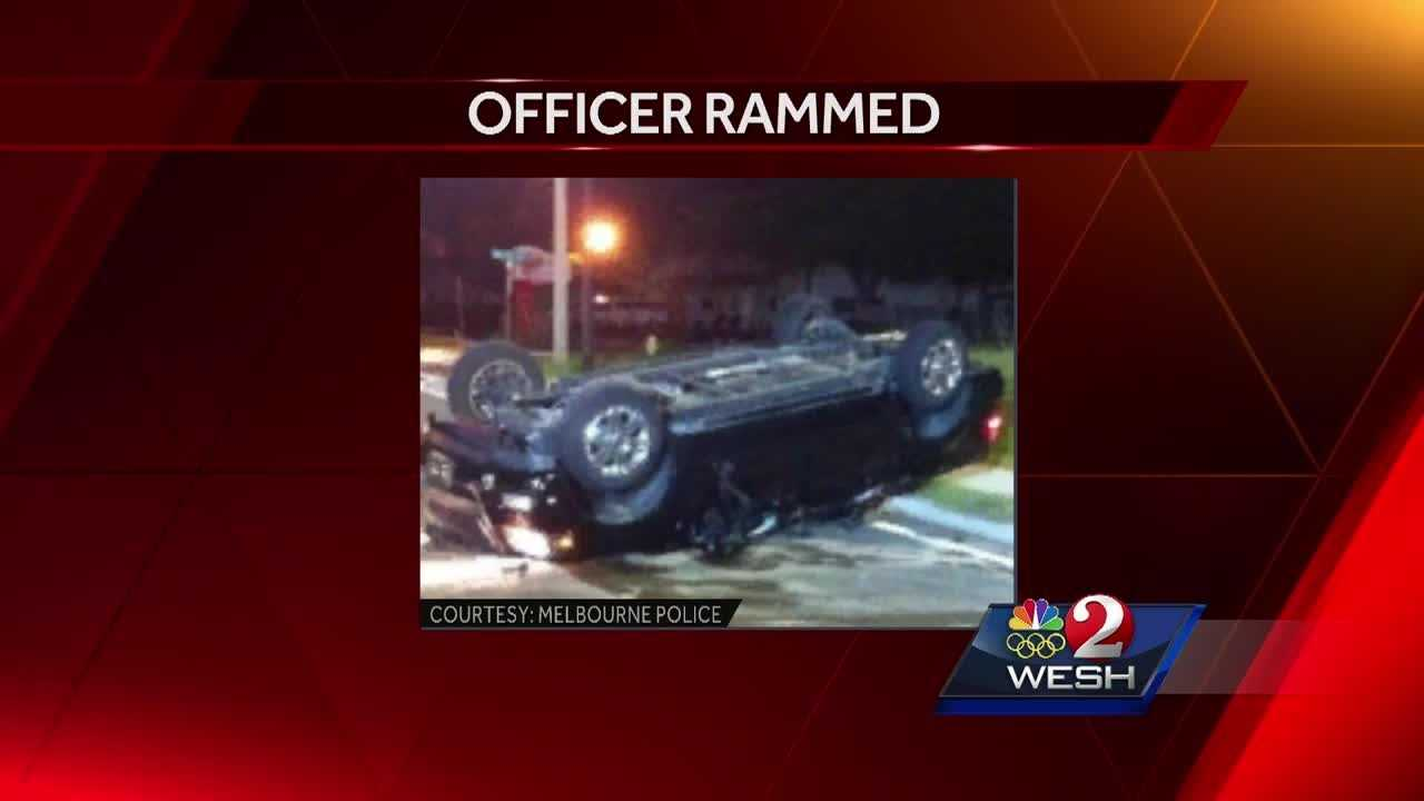 Officer rammed by suspect in stolen truck
