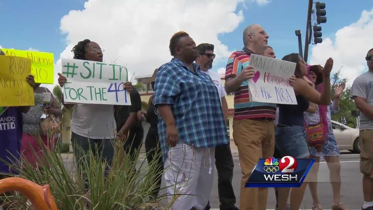 Sen. Marco Rubio met with an owner of a business recovering from the effects of the massacre at nearby Pulse nightclub. But outside, protesters showed that they remained unsatisfied with the recovery attempt for LGBTQ rights.