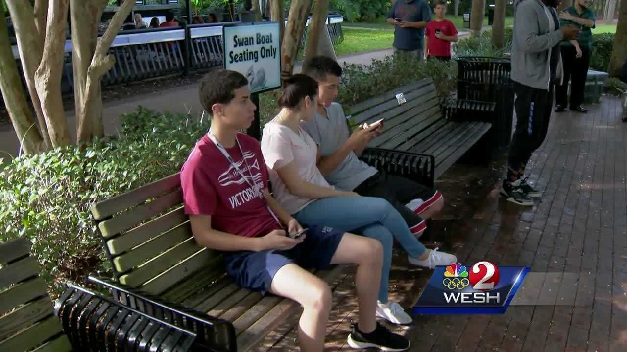 "Hundreds of people have been gathering at Lake Eola every night to play the wildly popular ""Pokemon Go."""