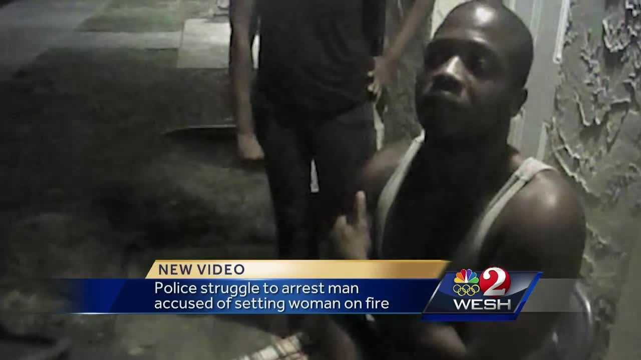 Video from an officer's body camera shows the arrest of a man who tried to fight off authorities after they say he doused his girlfriend in rubbing alcohol and set her on fire.