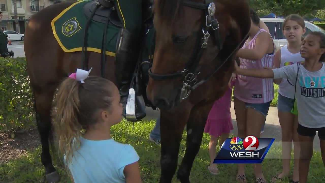 Sheriff Jerry Demings marked the 33rd annual National Night Out with a stop in the Independence subdivision, where the celebration included food, music, games, a bike parade and a visit from Florida Hospital's Florida Flight 1 helicopter.