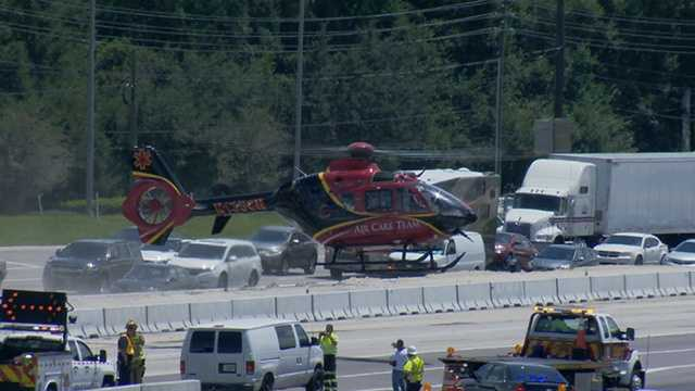 A helicopter flies a critically injured driver to Orlando Regional Medical Center.