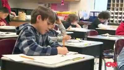 boy studying in school
