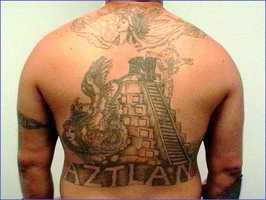 Mexikanemi gang members reportedly traffic multi-kilogram quantities of powdered cocaine, heroin and methamphetamine&#x3B; multi-ton quantities of marijuana&#x3B; and thousand-tablet quantities of ecstasy from Mexico into the U.S. for distribution both inside and outside prison.