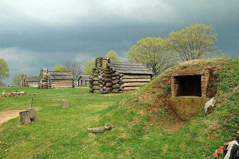 It became a national park in 1976 and has historical buildings, recreated encampment structures, memorials, museums, and recreation facilities.