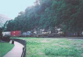 The railroad horseshoe curve has been in continuous operation since its opening, but has widened to three tracks from originally being one.