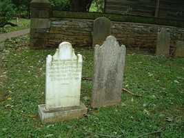 The site contains several buildings and sites, including a graveyard where many of the earliest members are buried.